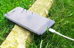 Telefon na trawie Obrazy Royalty Free