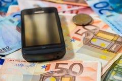 Telefon och pengar Fotografering för Bildbyråer