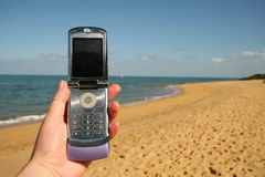 Telefon am Strand Stockbild