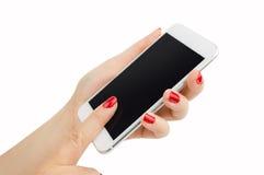 Telefon und Maniküre Stockfotografie