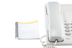 Telefon und Telefonbuch. Lizenzfreie Stockfotografie