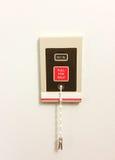 Telefon w sprawie nagłego wypadku światło na ścianie medyczny budynek Zdjęcie Stock