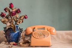 Telefon z roczników wizerunkami Fotografia Stock