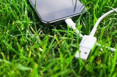 Telefon z USB kablem Obrazy Stock