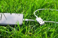 Telefon z USB kablem Obraz Stock