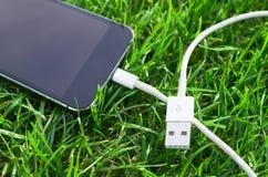 Telefon z USB kablem Fotografia Stock
