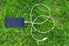 Telefon z USB kablem Zdjęcia Stock