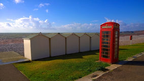TelefonASK på en strand Arkivfoton