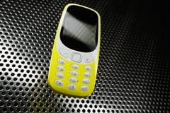 Telefone à prova de choque na superfície de metal Foto de Stock Royalty Free