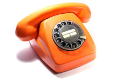 Telefone alaranjado velho isolado no fundo branco fotografia de stock royalty free