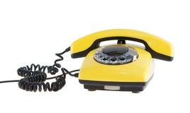 Telefone amarelo velho imagens de stock