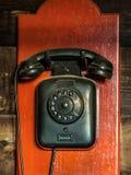 Telefone análogo antigo preto imagem de stock