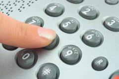 Telefone ao dedo do teclado e da mulher Imagem de Stock