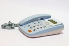 Telefone azul no fundo isolado Fotografia de Stock