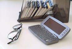 Telefone, cartões e vidros Foto de Stock