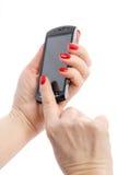 Telefone celular com mão Imagens de Stock Royalty Free