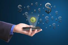 Telefone celular da posse do homem de negócios para o dinheiro do achado fotografia de stock royalty free
