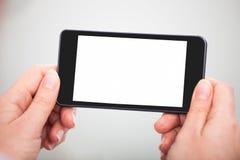 Telefone celular de With Blank Screen do empresário fotografia de stock