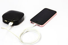 Telefone celular de carregamento Foto de Stock