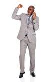 Telefone celular de fala do homem de negócio Fotos de Stock