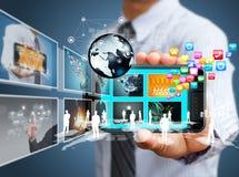 Telefone celular do tela táctil com homem de negócios Fotos de Stock