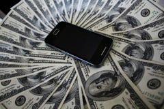 Telefone celular e cédulas Imagem de Stock