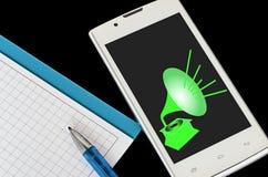 Telefone celular e caderno com pena imagens de stock royalty free