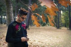 Telefone celular formado jovens imagem de stock royalty free