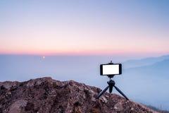 Telefone celular na montanha Foto de Stock Royalty Free