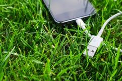 Telefone com cabo de USB Fotografia de Stock Royalty Free