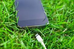Telefone com cabo de USB Imagens de Stock