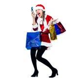 Telefone da compra do Natal de Papai Noel da mulher Fotografia de Stock