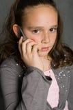 Telefone da menina e de pilha fotos de stock