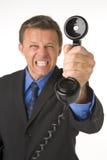 Telefone da terra arrendada do homem de negócios Fotografia de Stock