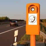 Telefone de emergência na borda da estrada Imagem de Stock Royalty Free