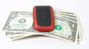 Telefone de pilha com dinheiro Foto de Stock Royalty Free