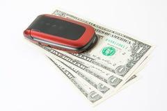 Telefone de pilha com dinheiro Fotos de Stock Royalty Free
