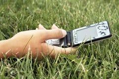 Telefone de pilha da terra arrendada da mão Imagem de Stock Royalty Free