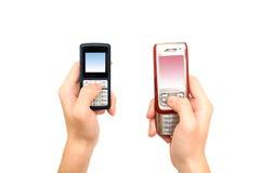 Telefone de pilha da terra arrendada da mão Foto de Stock