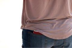 Telefone de pilha no bolso traseiro Imagens de Stock