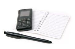 Telefone do bloco de notas, da pena e de pilha Imagem de Stock Royalty Free
