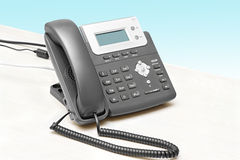 Telefone do IP com uma tabela do indicador Fotografia de Stock