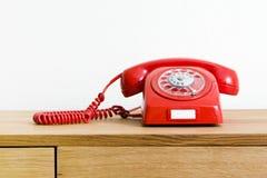 Telefone do vermelho do vintage Imagem de Stock Royalty Free