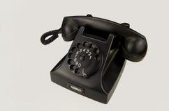 Telefone do vintage no fundo branco fotografia de stock