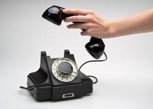 Telefone do vintage que está sendo pegarado Foto de Stock