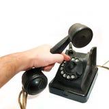 Telefone do vintage que está sendo pegarado Fotografia de Stock