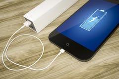 Telefone e banco espertos do poder Foto de Stock