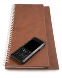 Telefone e caderno Fotografia de Stock Royalty Free