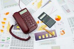 Telefone e calculadora prendidos Fotografia de Stock Royalty Free