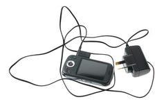 Telefone e carregador espertos imagem de stock